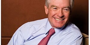 Charles Schwab on cover of Invested